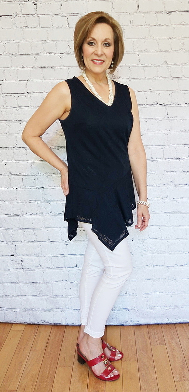 50 With Flair, Over 40 and 50 Fashion, Navy Asymetrical Lace Top, White Skinny Jeans, Red Sandals