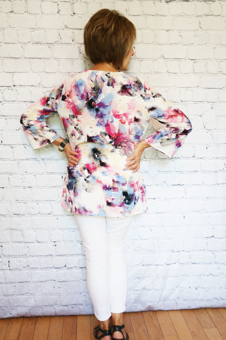 Over 50 Fashion, 50 With Flair, Watercolor Bell Sleeve Blouse, White Old Navy Jeans, Gladiator Wedge Sandals, Black Jewelry