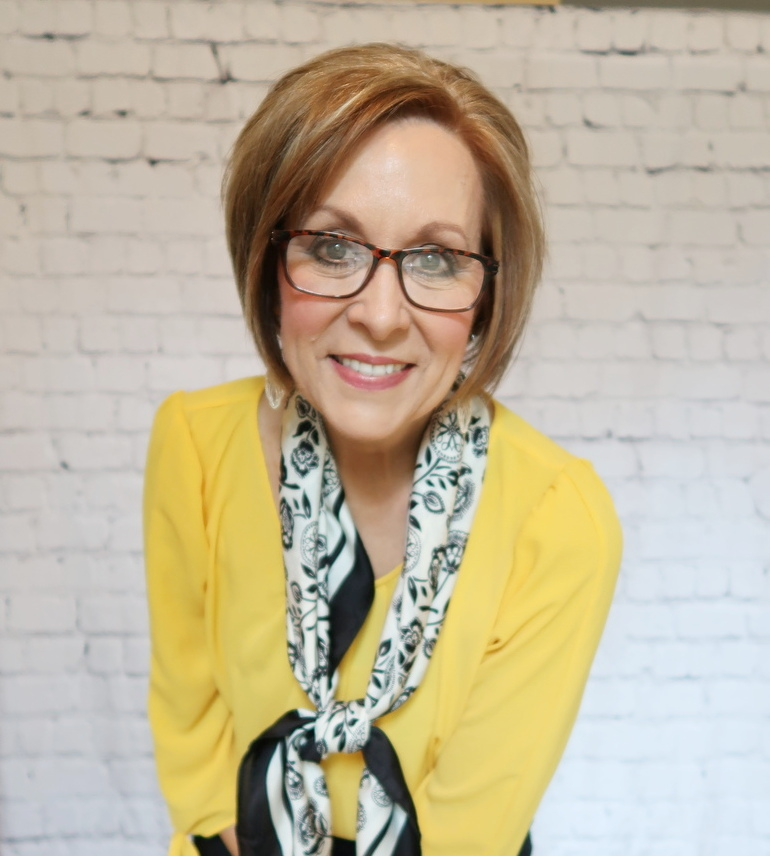 50 With Flair, Mustard Blouse with Tailored Black Pants, Black and White Scarf, Reading Glasses