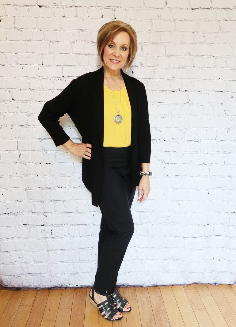 50 With Flair, Mustard Blouse with Tailored Black Pants, Silver Reading Pendant, Black Cardigan