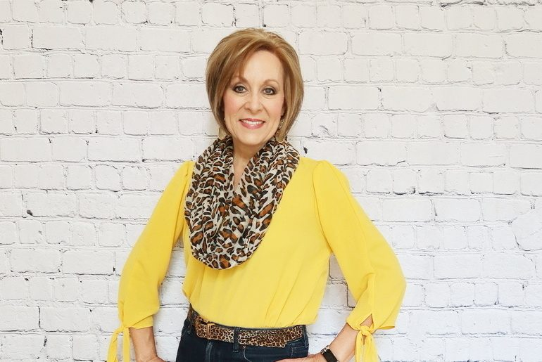 Over 50 Fashion, Fifty With Flair, Mustard Blouse, Cheetah accessories, cheetah heels, Fitbit, cheetah scarf