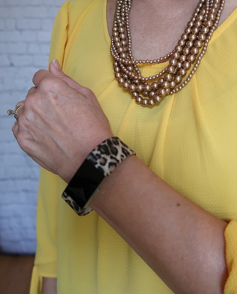Over 50 Fashion, Fifty With Flair, Mustard Blouse, Cheetah accessories, Fitbit, chocolate pearls