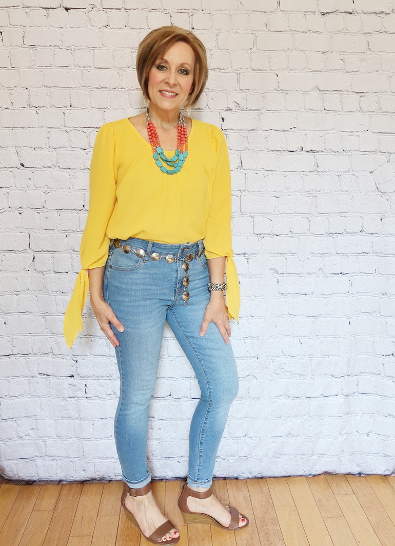 50 With Flair, Mustard Yellow Blouse, Light Denim Jeans, Denim Jacket, Wedge Sandals, Southwestern Accessories