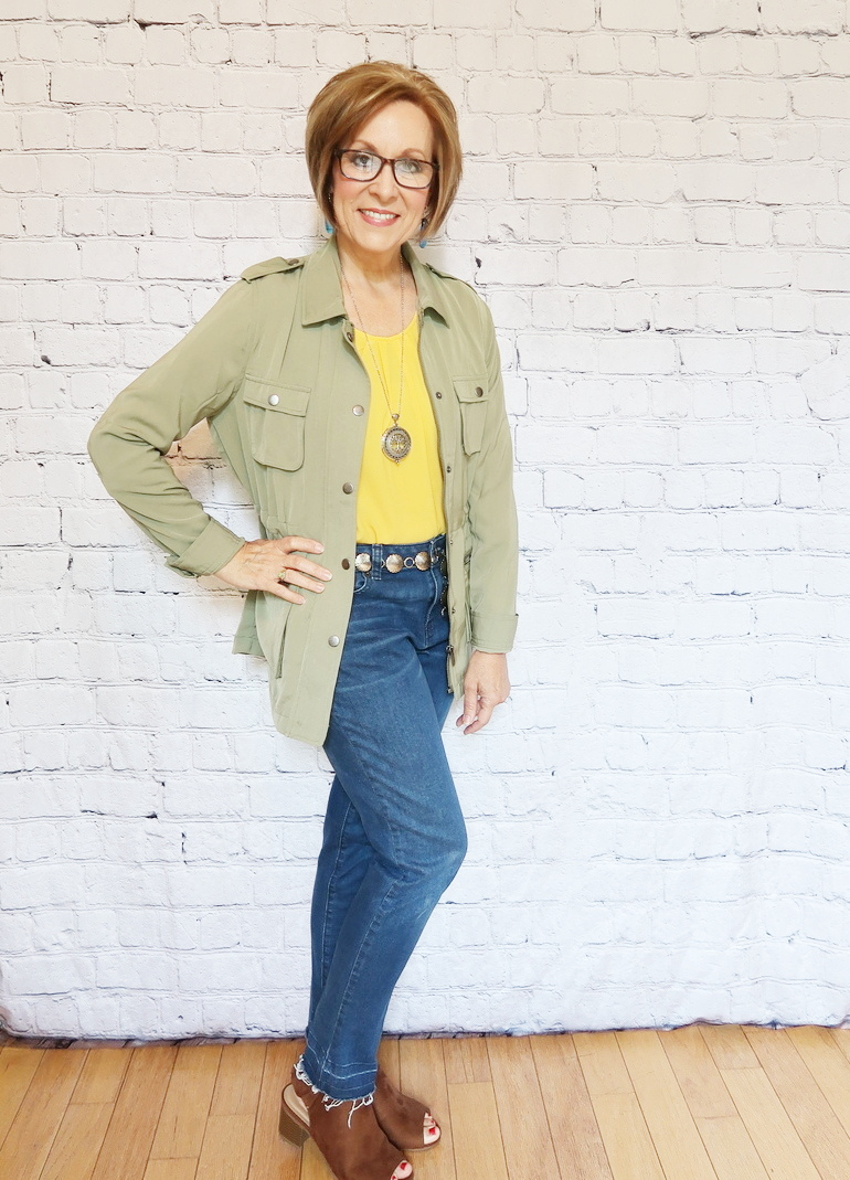 50 With Flair, Over 50 Fashion, Mustard Yellow Blouse, Dark Fray Jeans, Reader Pendant, Concho Belt, Olive Jacket, Fused Glass Earrings, Reading Glasses, Suede Sandal Bootie Chunky Heal